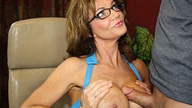 big tits auburn milf makes handjob