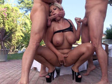 Filthy Latina slut Bridgette B does double blowjob outdoor